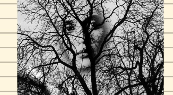 ghost face of woman in tree
