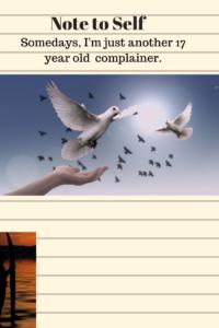 hand releasing white doves