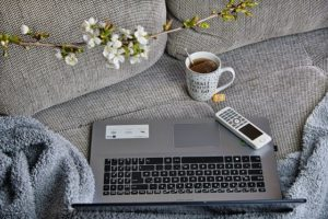 laptop coffee couch work station